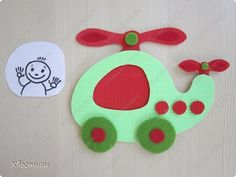 Here is a fotoramochka - HELICOPTER turned.  In this time of corrugated cardboard, only wheels and some decorative elements - made of felt.  photo 3