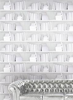 White bookshelf wallpaper & silver chesterfield sofa