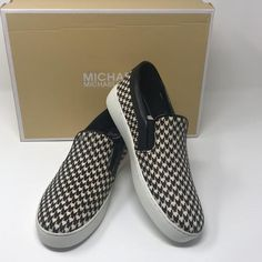 Get the must-have flats of this season! These MICHAEL Michael Kors Black/White Keaton Slip On Flats Size US 7 Regular (M, B) are a top 10 member favorite on Tradesy. Michael Kors Shoes, Michael Kors Black, Vans, Retail, Slip On, Black And White, Sneakers, Style, Fashion