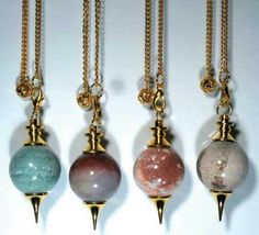 "These pendulums consist of various spherical gemstones with brass ornamentation on either end. They measure 10"" long overall with a 1 3/4"" long bob. It features a detachable chain with a clip on the end. Gemstones are chosen based on availability. $13.95"