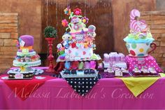My very own Alice in Wonderland Sweets Table creation for my sister's baby shower party... Featured AIW themed diaper cake, Mad Hatter diaper cake with tiered washcloth cupcakes, AIW favors also original creations of yours truly, MELISSA L. Playing card cake-iches, AIW cake pops and  cupcakes, Chesire cat themed cake push-ups made by SWEET BEA's of Beaumont, CA.