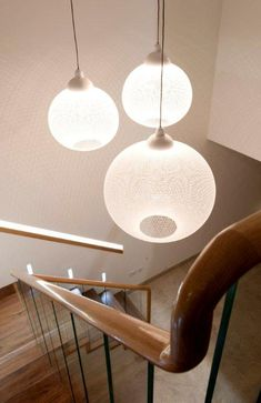 Unusual lighting when going up and down the stairs. Designed by James. Get matched with the right design professional for your home project on www.designforme.com