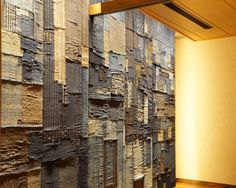 i love this idea for a dramatic and inexpensive wall treatment.  patchwork wall of indigo cloth scraps in tokyo hilton restaurant