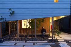 "Takeru Shoji Architects top a timber-clad house with a ""big hat"""