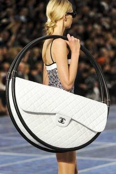 so Chanel was going for the recycled look.... she recycled hula hoops in this design! hahah kinda funny...