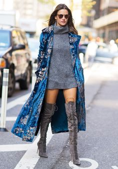 The Victoria's Secret Angel showed off her mile-long legs in a chunky knit gray turtleneck sweater than she donned sans pants. See her whole outfit here.