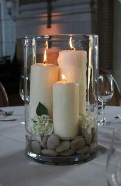 Pretty candle arrangement in glass with stones