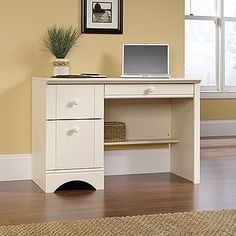 Large drawer/shelf with metal runners and safety stops features flip-down panel for keyboard/mouse.  Two drawers with patented T-lock assembly system feature metal runners and safety stops.  Lower drawer holds letter-size hanging files.  Finished on all sides.  Antiqued White finish.
