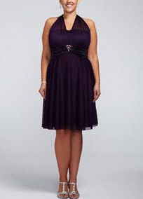 This is one dress that is sure to be your go-to favorite time and time again.   Illusion halter neckline ties in the back for a perfect fit.  Charmeuse trim and beaded brooch detail accent the empire waist of the short and flirty skirt.  Imported polyester. Fully lined. Hand wash only. Also available in missy sizes as Style 9006DB01.