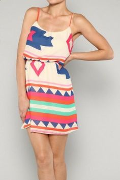 This sleeveless colorful aztec print dress is a necessity for warmer weather. Has an elastic band on waistline to show off those feminine curves. The colors on this dress will make your sunkissed skin stand out. Lined. 100% polyester