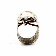 Distressed Sterling silver oval ring set with silver plated brass wire and a Swarovski CZ