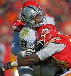 Oakland Raiders quarterback Terrelle Pryor (2) is sacked by Kansas City Chiefs outside linebackers Justin Houston (50) and Tamba Hali