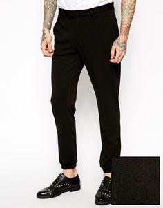 Hose von ASOS aus Jersey verdeckter Schlitz und Verschlusslasche Gürtelschlaufen an der Taille Seiten- und Gesäßtaschen enger Schnitt