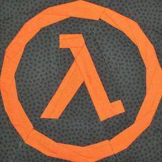 Half-Life Lambda paper pieced pattern designed by Jennifer Ofenstein for Fandom In Stitches http://fandominstitches.com