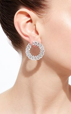 These **Vanleles** earrings features exquisite diamonds along its stunning silhouette which epitomizes the designer's ode to love and strength