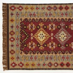 KAVITA KILIM--Traditional patterns play themselves out like poetry, trading rhyme and rhythm in this handwoven rug. It's made by skilled weavers who used traditional punja looms and juxtaposes gorgeous hues of burgundy and gold. Yarn-dyed wool/cotton. Imported. Dry clean. Sundance exclusive. 2-1/2' x 8', 4' x 6', 5' x 8' and 6' x 9'.