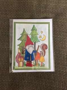 """Adorable colorful woodland fantasy hand painted stamped card of a gnome with his friends Mr Fox and Miss Squirrel walking among the pines.    This card is 6"""" by 4.5 """".    ~Comes with an envelope in a recloseable plastic sleeve.    ~Left blank inside for you to add your own personal message.    ~We add new unique cards daily, so come visit often!    Monique and Anita want to thank you for growing at MamaGuccis today! 