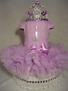 Purple princess diapercake with tutu and diamond tiara / Gâteau de couches princesse mauve avec tutu et couronne diamant. Order your custom diapercake here. Commandez votre gâteau de couches personnalisé ici. https://www.facebook.com/creationsdeMarieLou?ref=aymt_homepage_panel #showerbébé #cadeaunaissance #babyshower #birthgift