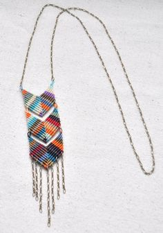 """Handwoven macrame chevrons using rare waxed nylon string from Brazil. 30"""" antique brass chain (nickel and lead free) Full necklace approximately 36"""" length"""