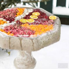 Once the birds have flown south, take advantage of your empty birdbath for this dazzling holiday decoration. Frozen sections of kumquat, cranberries, pepperberries, and polished stones provide a striking contrast to the bright white snow./