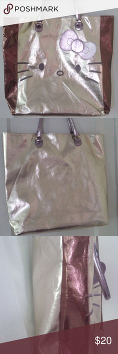 "Lightweight Metal Tones Hello Kitty Tote Bag EUC Licensed Hello Kitty Sanrio Bag  Bag is metal tones, shades of gold, bronze and silver, Lightweight and super functional, but the lame' type finish shows flaws easily - no rips, tears or stains, but imprints show up, 2 are pictured.  18x18  square. expands to 5"" in depth, and has a 7"" strap drop  One large inside pocket that closes with a snap, with a couple of  smaller inside pockets Hello Kitty Bags Totes"