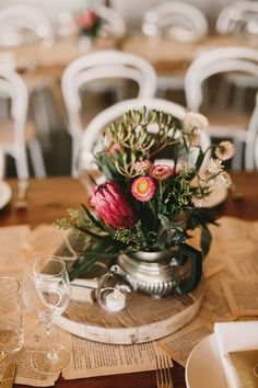 Lovely magenta blooms in a silver vase | Zoe Morely Photography