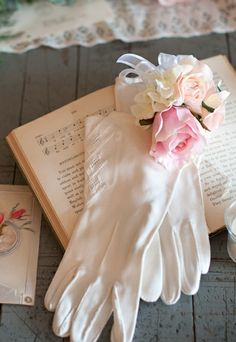 Pink Wedding Corsage THinking a light yellow and white mini rose or 2 or 3 and a piece of a hydrengea near the bottom.