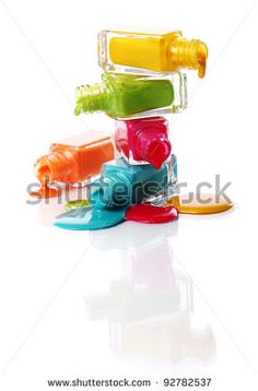 Bottles with spilled nail polish over white background by Yeko Photo Studio, via ShutterStock