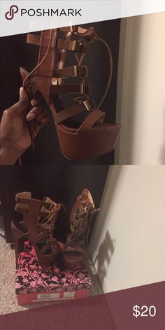 Tan lace up platform heels. Tan platform, super high heels. 6 inches... Never been worn. Bought from another posher, says they were the stock shoes on a mannequin so there is a hole on the bottom. But doesn't affect the wear. Shoes Lace Up Boots