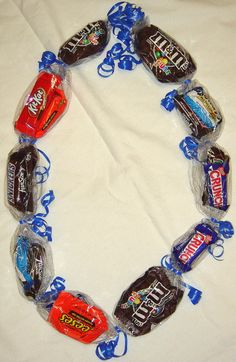 A friend made me a Ghirardelli-Candy-Lei for graduation, and I loved it! Great gift idea :)
