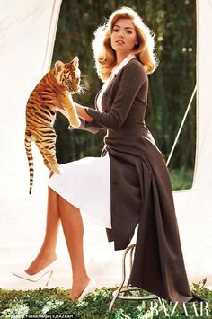 Kate Upton poses with endangered baby animals in Bazaar May 2013