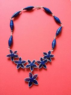 Navy blue, Quilling necklace, quilling paper necklace, quilling paper flower, boho necklace. Made of paper with quilling techniques, paper beads and seed beads. Varnished for moisture rezistance. Nickel free pins. Very light weight.  Approximate dimensions are 40 cm open. Short necklace, neckline. Please note that the color may vary depending on your computer monitor setting. | Shop this product here: spreesy.com/Crochetbutique/16 | Shop all of our products at…