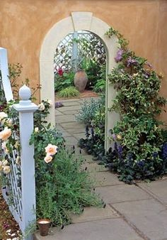 I love this idea. A well positioned mirror in a small courtyard to produce the illusion of a secret garden beyond.