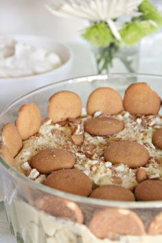 Southern Banana Pudding features classic, creamy homemade custard with bananas, vanilla wafers, and whipped cream.   inasouthernkitchen.com