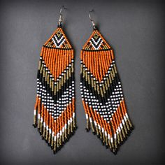 Long seed bead earrings with fringe. These earrings made with tiny japanese seed beads Miyuki delica. Ear wires are surgical steel. Measurements: Length - 12 cm / 4.7 (including ear wires). Width - 2,5 cm / 1 More beaded earrings from my shop you can see here: