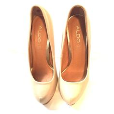 Tan and Gold heels. *Leather* Tan leather with Gold 5 inch heel. Shoe also has small platform sole. Great condition. Looks good with jeans! ALDO Shoes Heels