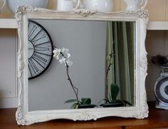 French Style Shabby Chic Mirror    This vintage mirror has been hand painted in Old white by Annie Sloan Chalk Paint and waxed to high light her lovely details ...Chch tme  59cmx 49.5
