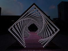 Building A Computer 790592909572846744 - A Towering Organic Structure Built From Material as Thin as a Coin – Accumulation: A Dramatic Concentric Tunnel of Light Patterns by Yang Minha – Source by Mawa Design, Event Design, Grid Design, Booth Design, Light Art Installation, Art Installations, Landscape Architecture, Landscape Design, Futuristic Architecture