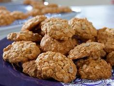 80 calorie oatmeal chocolate chip cookies. Try with half wheat flour and half white flour.