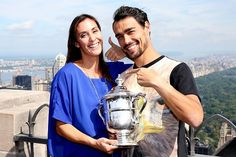 9/13/15 Via  Tennis Photos:   Sharing everything: #FabioFognini poses with fiance #FlaviaPennetta's @usopen trophy! Flavia announced on-court that she plans to retire from tennis this year.