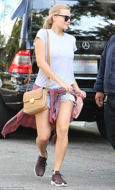 Who like short shorts? Margot Robbie showed off her toned legs on Wednesday when she was s...