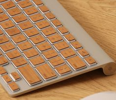 Pimp your keyboard with this wooden awesomeness. We're smitten.