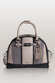 Looking for trendy womens bags? Look no further as GUESS can give you what you need. GUESS designs are what sets them apart,and keep them at the top of the fashion world. I adore all Guess products like this MARIOLINA TRAVEL DOME BAG. A smart choice for business or pleasure travel, this oversized crocodile-embossed bag is big on space and style. GUESS is synonymous with glamorous style at an affordable price…