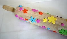 foam stickers on a rolling pin. Roll through paint to create awesome prints.