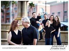 take a special photo for each 'family' with them in the foreground, extended family in the background