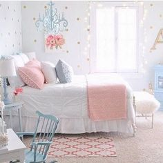 adorable girl's room with polka dot wall paper and shades of pink