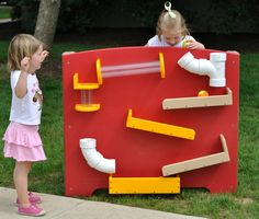 Watch as the ball travels through tubes, pipes and chutes. A Tracking Panel on your outdoor preschool playground allows children to observe and demonstrate directional words. They can visually track the object as it goes fast, faster and slower. When children use a variety of objects and compare the speed of travel, they learn about physical properties and cause and effect.  The Tracking Panel is also available in cedar for your natural playground.