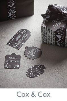 Christmas Gift Tags, Christmas Wrapping, White Ink, Black And White, Paper Targets, Ink Splatter, Cox And Cox, Christmas Trends, Printed Ribbon