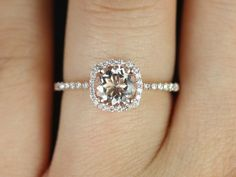 Petite Version 14kt Rose Gold Thin Morganite Cushion Halo Engagement Ring (Other metals and stone options available). $675.00, via Etsy.
