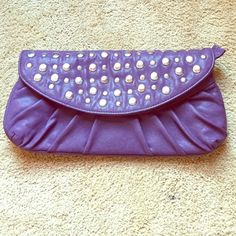 Purple studded clutch Used once for a wedding and never again. Basically new. Brand marked for exposure Anthropologie Bags
